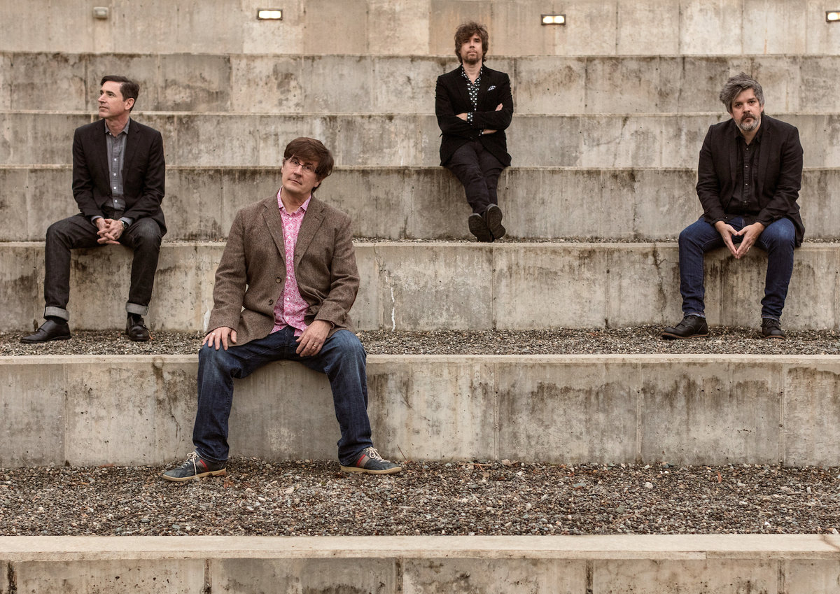 """The Mountain Goats Bring Out """"Cadaver Sniffing Dogs"""" in New Song"""